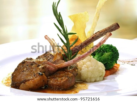 Gourmet  Main Entree Course Grilled Lamb steak with spicy Pepper sauce. - stock photo