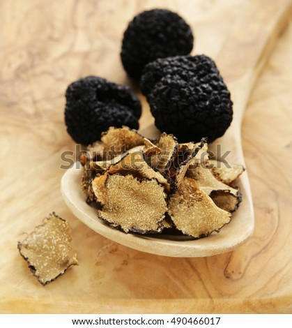 gourmet mushroom black truffle fresh and dry on wooden background