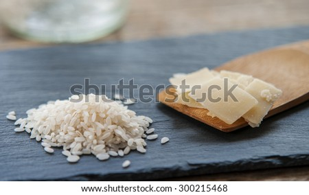 Gourmet Organic Parmesan Cheese on a Background with rice - stock photo
