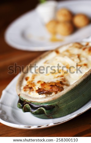 Gourmet pancakes stuffed with cream cheese and ham, with chess balls, selective focus.  - stock photo