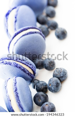 Gourmet small colorful French macarons with blueberry flavor.