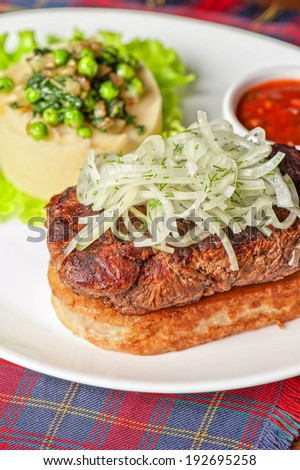 Gourmet steak meat with potato, vegetables and sauce