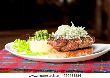 Gourmet steak meat with potato, vegetables and sauce - stock photo