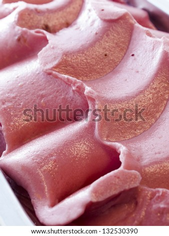 Gourmet sweet orange and cranberry gelato on white background.