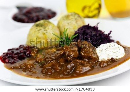 Gourmet Venison goulash with potato dumplings and garnish
