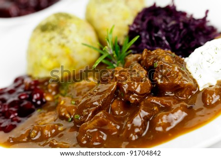 Gourmet Venison goulash with potato dumplings and garnish - stock photo