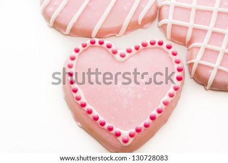 Gourtmet heart shaped cookies decorated for Valentine's Day.