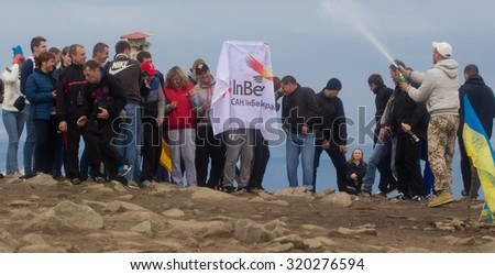 GOVERLA, UKRAINE - SEPTEMBER 20, 2015 : A group of tourists AB InBev company climbs to the highest mountain of Ukraine Hoverla 2061 METER on SEPTEMBER 20, 2015