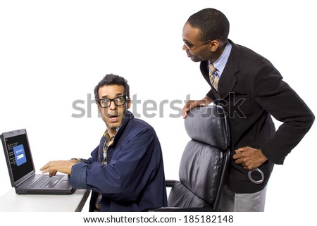 Goverment Agent Protecting a Computer from a Hacker - stock photo