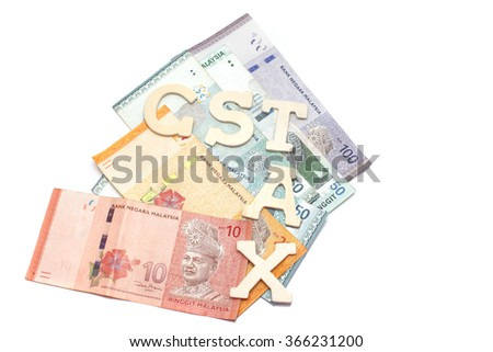 Government Service Tax concept. Money on white background with GST alphabet letters. - stock photo