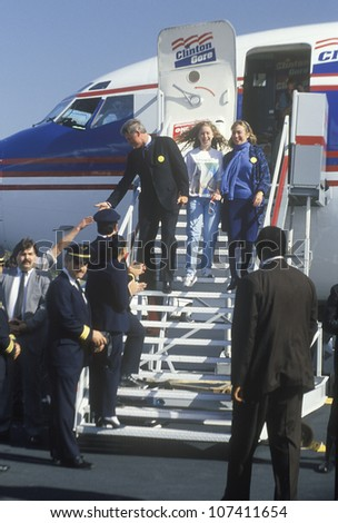 Governor Bill Clinton, wife Hillary and daughter Chelsea disembark an airplane on Election Day Nov. 3 of 1992 in Little Rock, Arkansas - stock photo