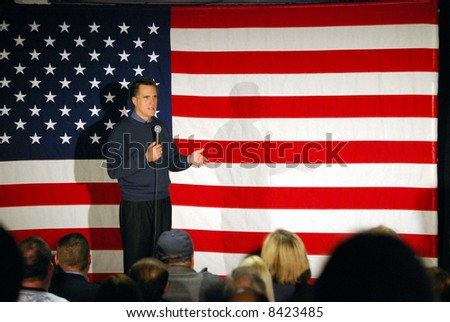 Governor Mitt Romney speaking in front of US flag - stock photo