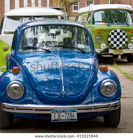 GOVERNORS ISLAND, NEW YORK - CIRCA 2014: Volkswagen Beetle cars and bus parked - stock photo