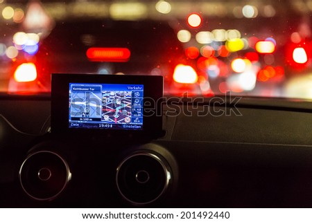 GPS device in a car at night - stock photo
