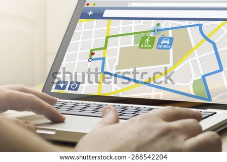 GPS satellite navigation, travel, tourism and location route planning business concept: man using a laptop with job application on the screen. Screen graphics are made up. - stock photo
