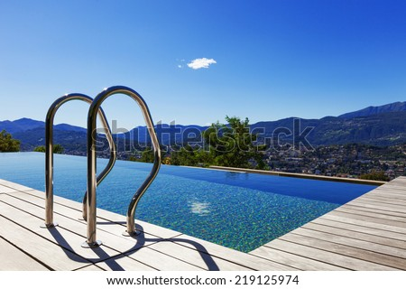 Grab bars ladder in the swimming pool, outdoor - stock photo