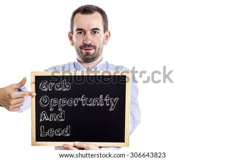 Grab Opportunity And Lead GOAL - Young businessman with blackboard - isolated on white