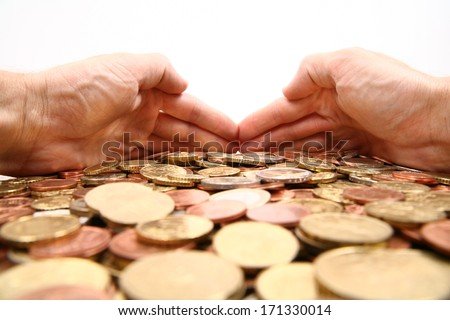 grabbing all the money, hands grabbing coins isolated/white background - stock photo