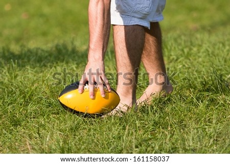 Grabbing an American Football Ball
