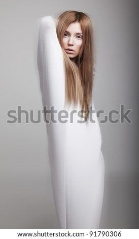 Graceful female silhouette in white clothes - studio shot - stock photo
