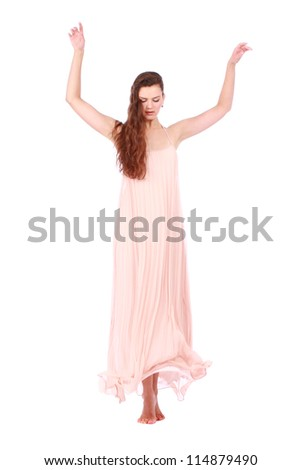 graceful girl in flying light pink dress, isolated on a white background - stock photo