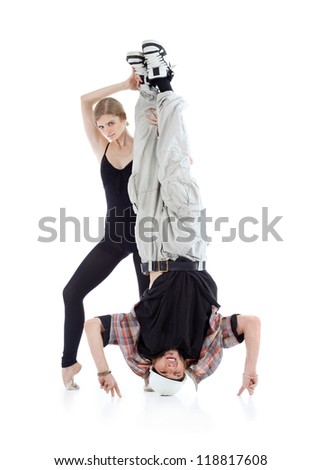 Graceful gymnast holds breakdancer legs isolated on white background. - stock photo