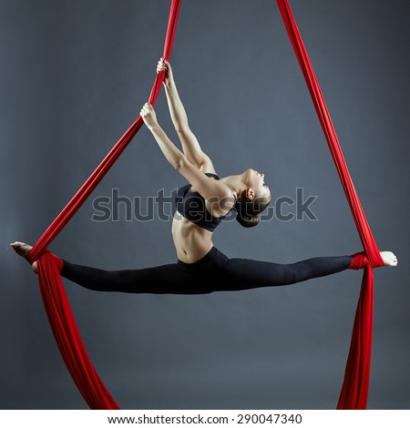 Graceful gymnast performing aerial exercise - stock photo