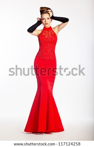 Graceful newlywed in luxurious wedding red dress. Perfection. Luxury and glamour - stock photo