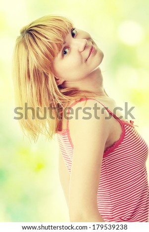 Graceful woman posing on abstract green background  - stock photo