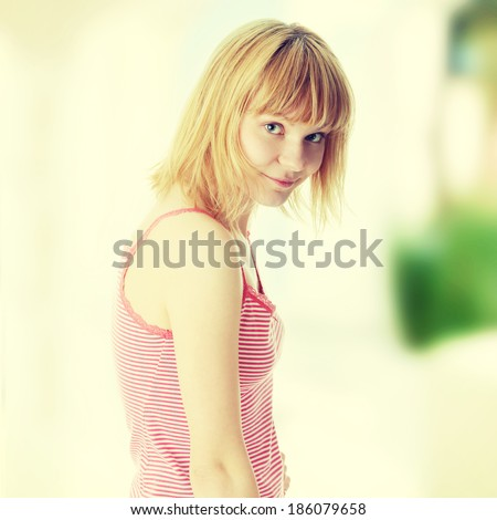 Graceful young blond woman in underwear posing - stock photo