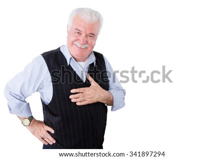 Gracious polite elderly man showing his gratitude and thanks holding his hand to his heart and looking at the camera with a beaming smile, isolated on white - stock photo