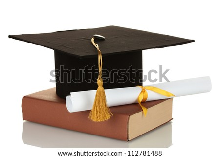 Grad hat and diploma with book isolated on white - stock photo