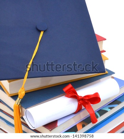 Grad hat and diploma with books isolated on background - stock photo