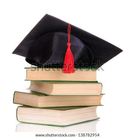 Grad hat with books isolated on white - stock photo