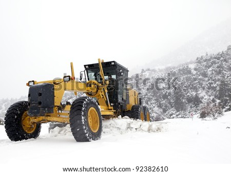 grader and snow