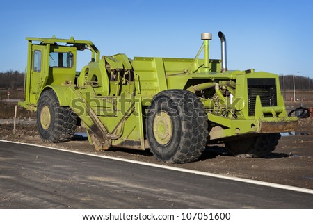 Grader in a new suburb - stock photo