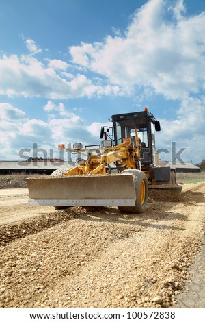 Grader working at road construction site - stock photo