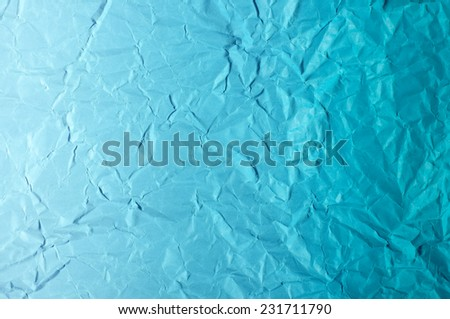 Gradient blue color wrinkled paper wallpaper - stock photo