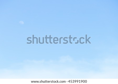 Gradient of blue color, soft color gradient of fluffy cloud and half moon on a day light sky background, use for business presentation background or desktop wallpaper - stock photo