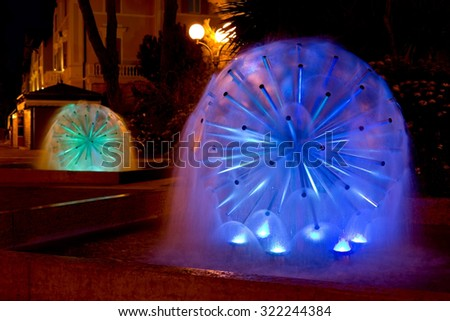 Grado, ITALY - 21 September 2015: Illuminated fountains in a park  in Grado, Italy. Grado is a well-known holiday destination.
