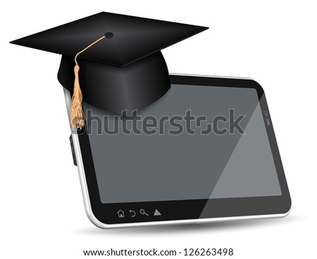 Graduate cap sitting on top of PC tablet / Internet education - stock photo