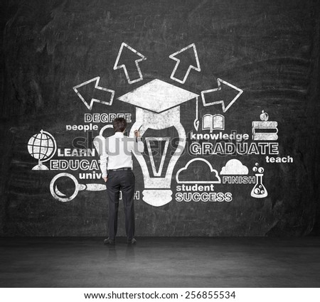 graduate drawing education concept on wall - stock photo