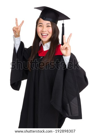 Graduate girl student showing victory sign