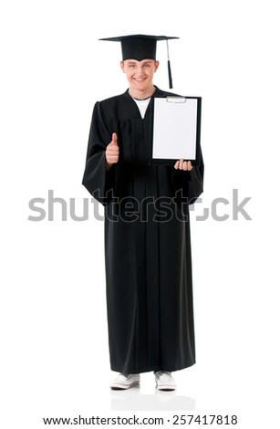 Graduate guy student in mantle showing blank placard board and thumb up, isolated on white background - stock photo