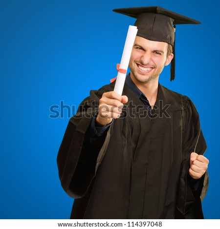 Graduate Man Holding Degree Isolated On Blue Background - stock photo