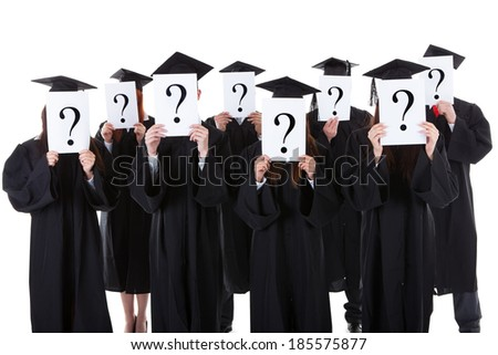 Graduate students covering face with question signs. Isolated on white