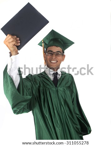 Graduate with diploma in cap and gown - stock photo