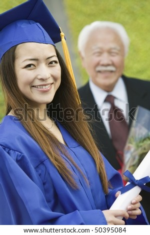 Graduate with Grandfather behind, outside, portrait