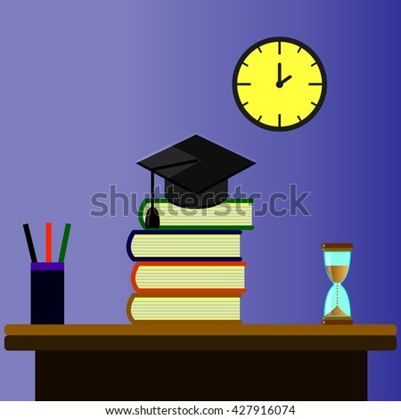 graduate work table on which lay a pile of books, an hourglass, glass pens and pencils on a blue background and yellow mechanical watches - stock photo