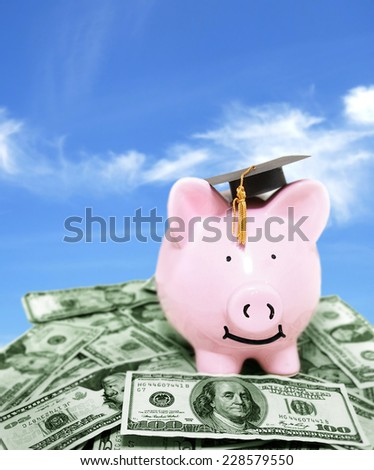 Graduating smiling piggy bank on money pile